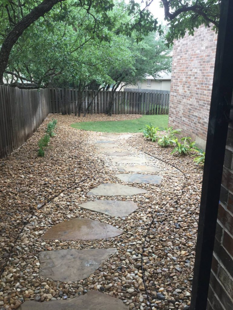 gravel walkway with stone steps