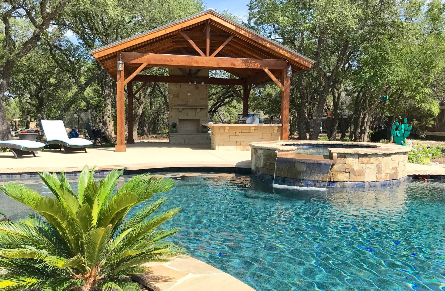 Covered patio and outdoor kitchen by Best of Texas Landscapes in Leander, Texas