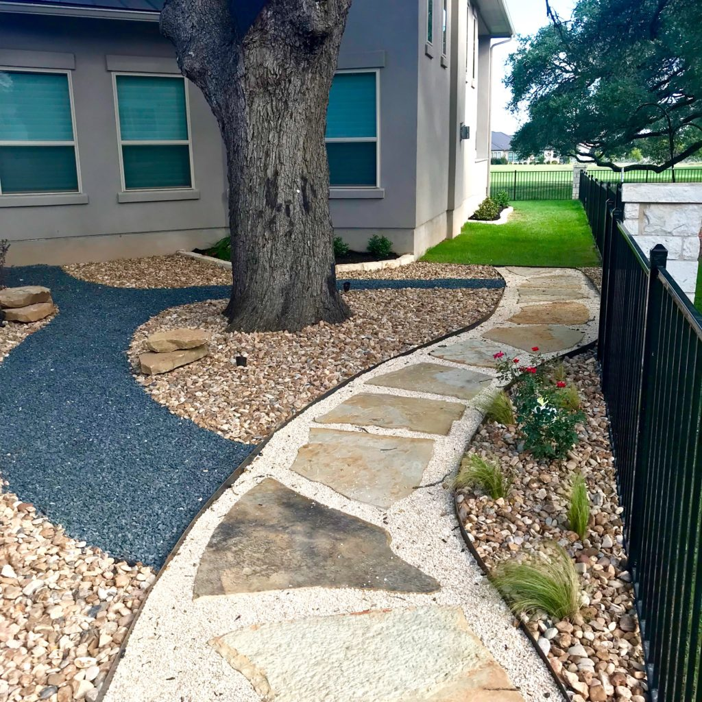 natural stone walkway with gravel and rock and plant accents