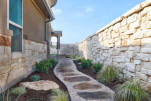 Natural rock path and landscape design by Best of Texas Landscapes