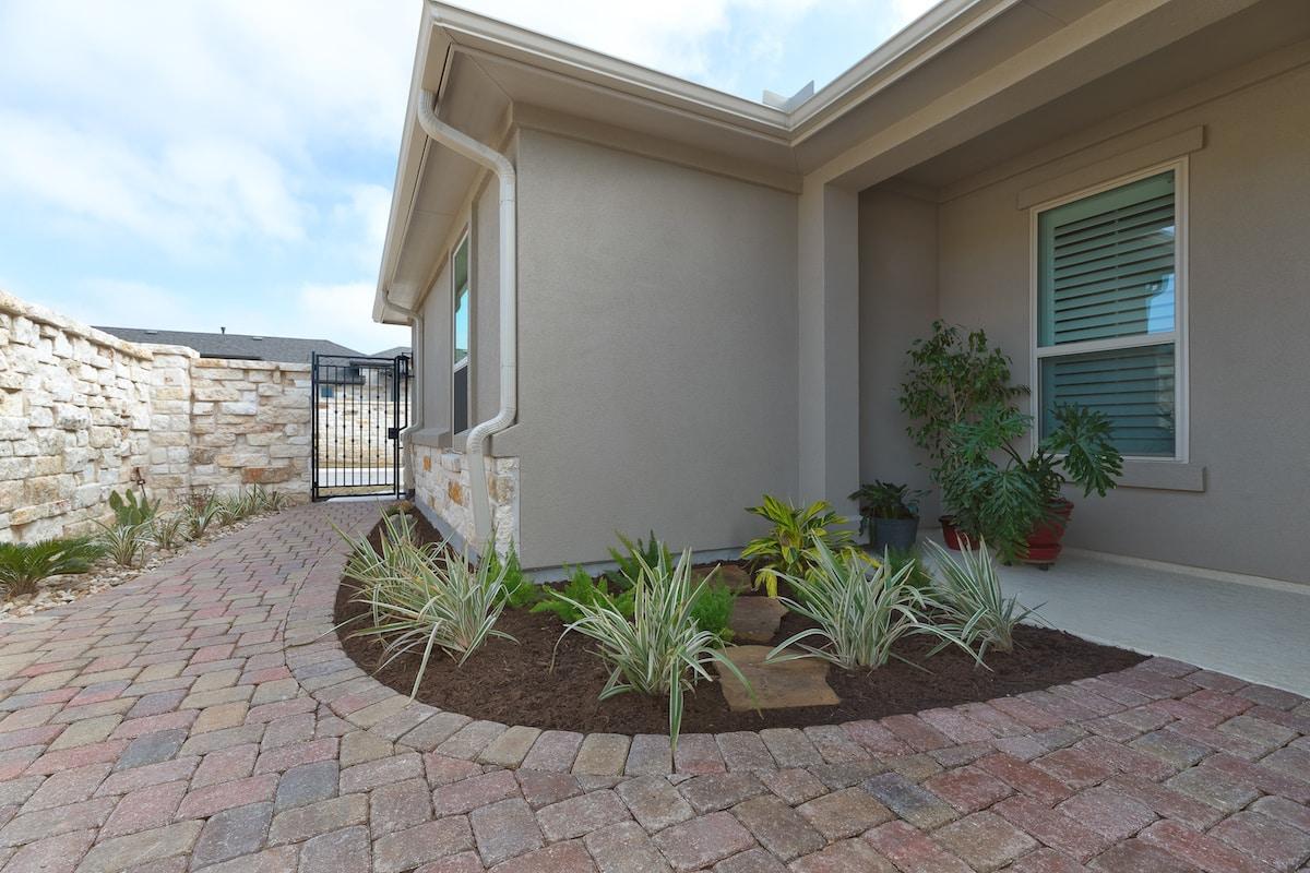 Front patio landscape design by Best of Texas Landscapes