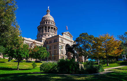 Texas capitol building with leaves changing colors